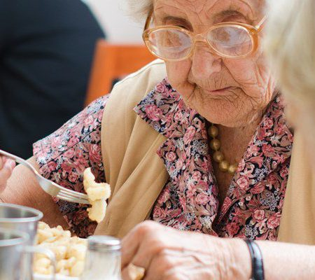 Elderly woman eating